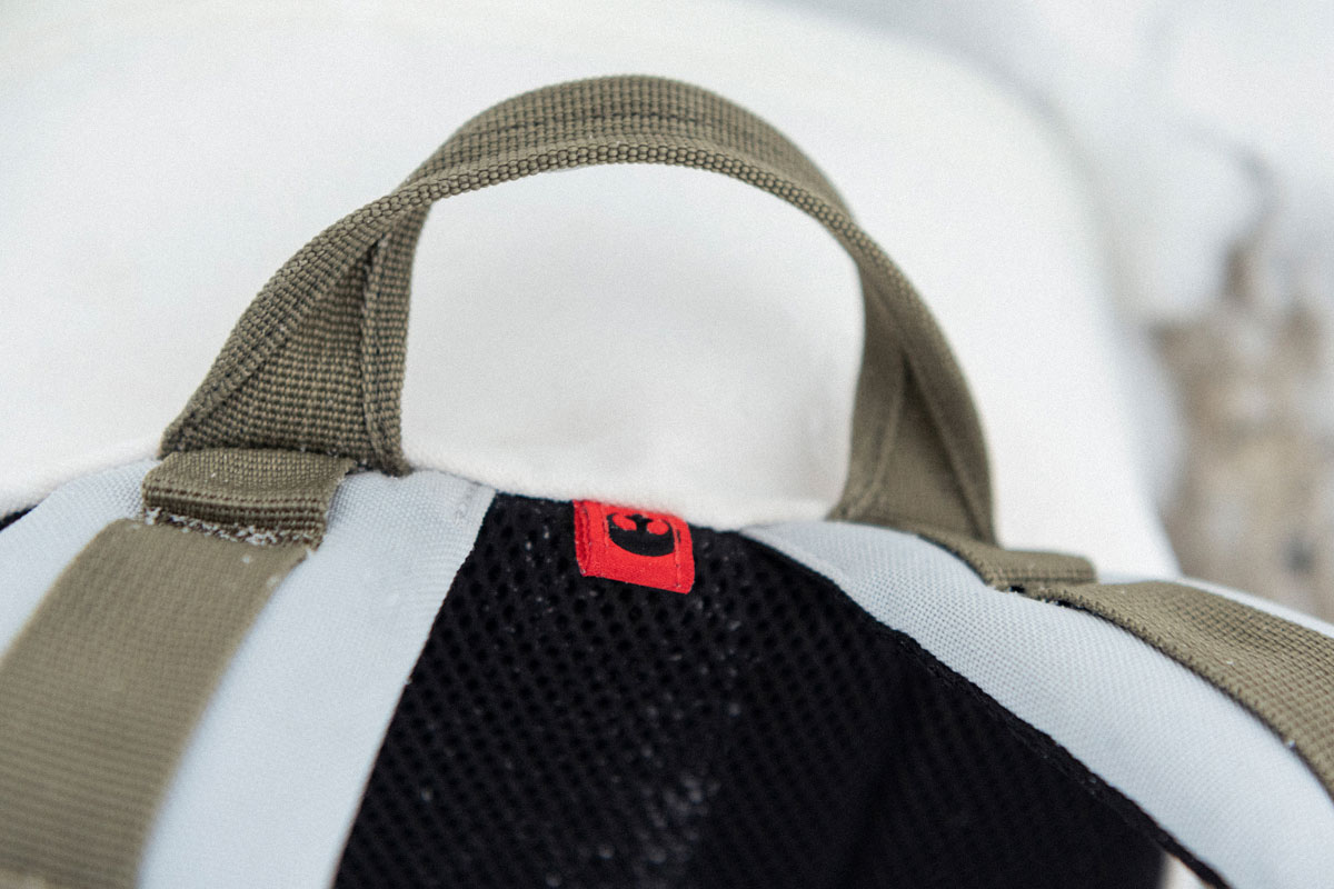 close up shot of the rebel alliance tab on the side of the front pocket of the bag